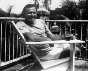Ernest Hemingway, possibly leaving a stain on his six-word story. (image via wikimedia)